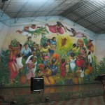 a mural behind the stage