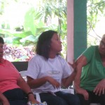 Dalena (center) translating the mothers stories