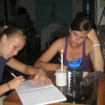 Erin and Amy journaling by candlelight
