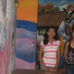 two of the Cultural Center's students giving the mural tour