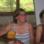 Mary trying to get the straw in the coconut