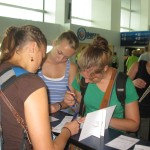Lynelle, Erin & Breanna filling out customs forms