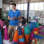 Kyle explaining the process of making pinatas
