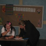 Arielle's teacher working with a student