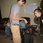 Kyle helping Alli weigh her suitcase