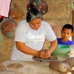 A local resident demonstrates how she makes pottery on the wheel