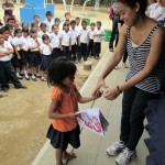 Giving donations to the students