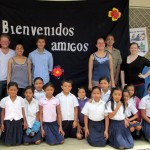 Sudents at the Concepcion de Maria primary school pose with their banner