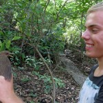 A Dutch student doing research at the station holds a zenzontle, the northern mocking bird