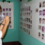Ali and Josh view pictures of those who died during the wars with the Somoza dictatorship or the Contras