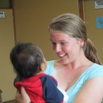Becky and an infant patient at the clinic in La Concepcion