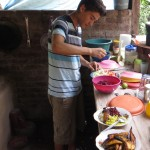 Alejandro helps prepare lunch.
