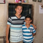Alejandro with his little brother, Monchito.