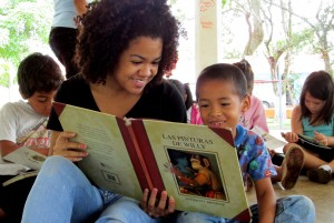 Cora reads a story to one of the boys.