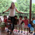 Elise with several of the children she works with in the afternoons.
