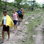 Maria's sister leads us on the rocky path to her home.