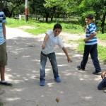 One of the boys shows Alejandro his throw technique.