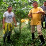 Seth helps Vicente with work on the coffee farm.