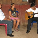 Teodoro and Timotea sing while accompanied by a friend, Jonathon.