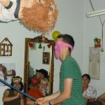 Peter takes a whack at the piñata