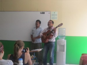 Humberto and Cesar sing the anthem of the crusade against illiteracy