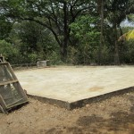 After depulping, fermenting, and washing the coffee cherries, they are dried to 11% humidity on this concrete slab.