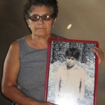 Francesca holds a picture of her son Javier, who was 14 years old when he was killed by the Contras.