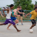 Natalie drives toward the ball during the soccer game with Miskito youth