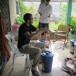 Wade and Peter preparing their water filters for travel to their respective service locations.