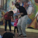 Isaiah dancing with his host sister and niece.