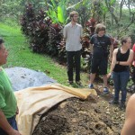 Students learn about the natural fertilizer the farm makes to offer rich nutrients for the coffee plants and more.