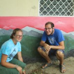 Erin and Wade outside one of the central buildings in El Lagartillo that houses a health center, classrooms and library.