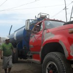 Willy arrives with a water truck