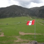 The Peruvian flag waves over the battlefield