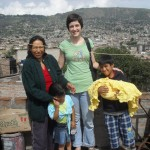 Elizabeth with several members of her host family on the roof of their home