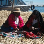 Residents of Uros Island demonstrate how they barter for goods