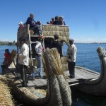 Boarding a reed boat bound for a neighboring island