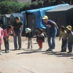 Gathering children for a public health project in the tent city nearby