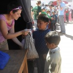 Distributing hand-sewn bags of personal hygeine supplies
