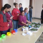 Alicia Taipe Tello shows some of the herbs used in traditional medicine
