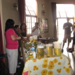 Alicia presents a workshop on medicinal teas; study coordinator Celia translates