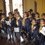 a spontaneous concert by school children preparing for a Mass