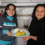 Rosemary and Mervi serving lunch at Casa Goshen