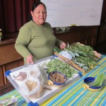 Alicia Taipe Tello showing a variety of medicinal herbs