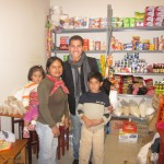 Samuel in the small store run by members of his host family