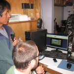 Benjamin shows Andres a web broadcast of a sports show he taped at GC last semester
