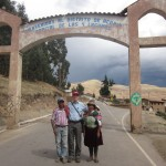 Joshua with his host father, mother and sister (on her mother's back) at the town gate