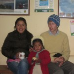 With Sandra and his youngest sister, Maya, inside Yachay Wasi