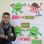 Samuel stands next to a poster he helped design for the upcoming health campaign