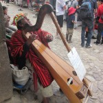 A blind musician playing his harp